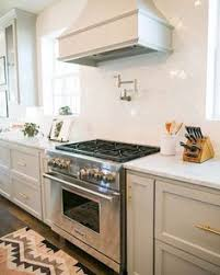 White Glass Backsplash by Milk And Honey Home Kitchens White Glass Tile White Ice Glass