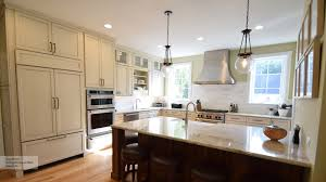 kitchen images gallery cabinet pictures omega casual kitchen with off white glazed cabinets and a dark kitchen island