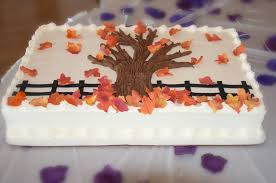 fall wedding sheet cake with a carved heart with names on a tree