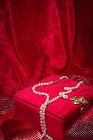 pearl necklace jewelry box images Pearl necklace cascades from jewelry box on red velvet background jpg