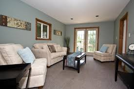 family room beige warm paint colors ideas with brown curtain and