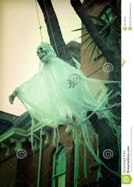 scary ghost decoration for halloween outside of house stock photo