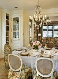 chic french country style dining room with vintage chandelier