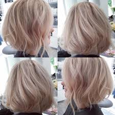 hair platinum highlights s blowout angled bob with tousled waves on hair with