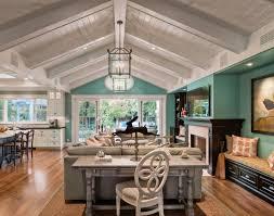 Vaulted Ceiling Open Floor Plans Turquoise Walls White Panel Ceiling White Kitchen Dark Floors