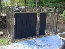 louvered fence slats add privacy for ornamental steel fencing