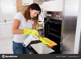 Cleaning Kitchen Woman Cleaning Oven In Kitchen U2014 Stock Photo Andreypopov 137846898