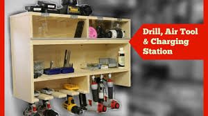 drill charging station with air tool storage and dust free bins