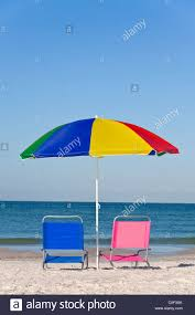 Chairs On A Beach Pink And Blue Deck Chairs On A Beach Underneath A Colorful