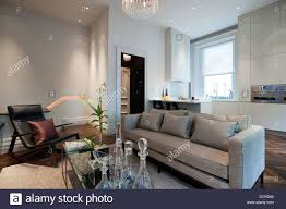 seating area with open plan kitchen in london city apartment stock