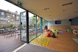 kids play room baby kids toddler playroom with wood flooring and playroom carpet