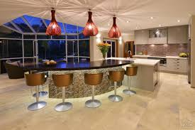 Curved Kitchen Island by Renovated Kitchen With Metallic Curved Island Front And Patterned
