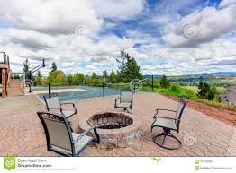 house backyard with sport court and patio area stock photo image