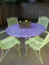spray painted brightly colored wicker and wrought iron patio