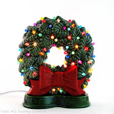 old time green ceramic christmas wreath for window sill with big