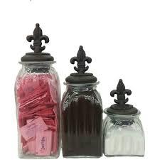 fleur de lis kitchen canisters fleur de lis topped glass canisters set of 3