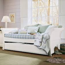 bedroom wood daybed with pull out trundle using rounded knobs in