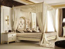 wooden canopy bed with golden list ornaments combined with