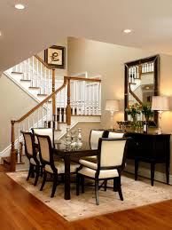 this stylish dining room with dark brown and cream accents could