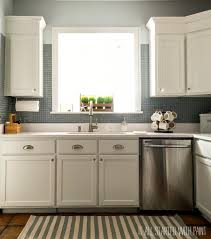 white kitchen cabinets with blue tiles builder grade kitchen makeover with white paint