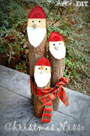 the santa logs christmas craft is super easy to make out of cedar
