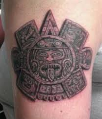 aztec sun god on biceps tattooshunt com