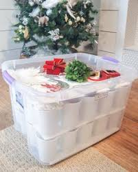 to safely store tree ornaments glue plastic cups to cardboard and