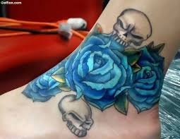 attractive skull and blue rose tattoo design on ankle golfian com