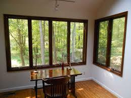 interior wonderful black glass corner window with birch wood frame