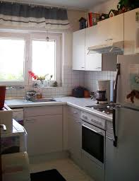 Modern White Wood Kitchen Cabinets Kitchen Brown Wood Flooring White Hanging Lamps Brown Wood