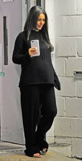 pregnant u0027 cheryl shows off her bump in comfy black sweats as she