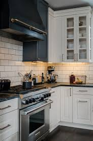 antique white kitchen cabinets with subway tile backsplash white subway tile with gray grout design ideas