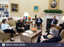 president barack obama convenes an oval office meeting with his