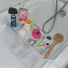 umbra aquala bathtub caddy expandable bath caddy with book stand umbra aquala expandable