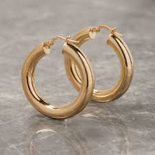 gold hoop earings thick hoop earrings in gold or silver by loel co