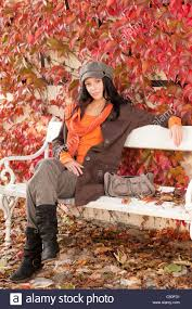 autumn park scenery young woman relax on bench fashion model stock