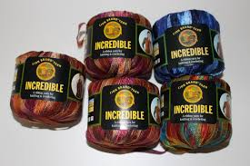 lot of 5 lion brand incredible ribbon yarn variegated skeins rolls