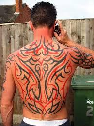 26 dramatic back tribal tattoos