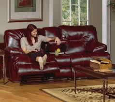 dark red leather sofa reclining console love seat with storage and cupholders in dark red