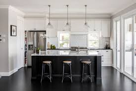 white kitchen cupboards black bench disappearing range hoods a new trend