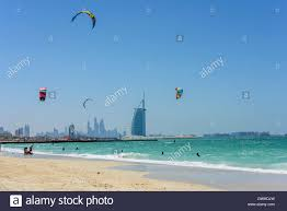 kite surf in dubai with the famous burj al arab hotel in