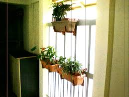 pretty gardens deck rail planter makes great small space gardens