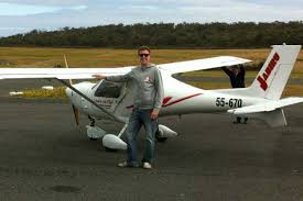 Ultra Light Airplanes Newcastle Pilot Shayd Hector Stands In Front Of An Ultralight
