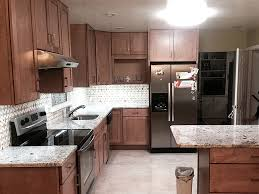 maple kitchen cabinets with white granite countertops glacier white granite countertop with honey onyx tile