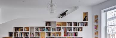 home design for book lovers light filled home for book lovers and their cute cats is built of