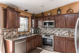 traditional kitchen with flush limestone tile floors in appleton