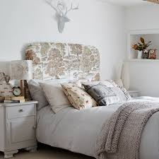 upholstered bedroom headboard installed in the bedroom with white