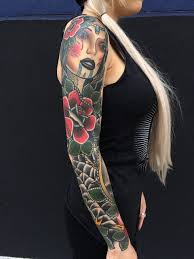 traditional ship with rose and skull tattoo on full sleeve