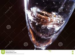 glass wedding rings wedding rings in a glass of water and air bubbles stock photo