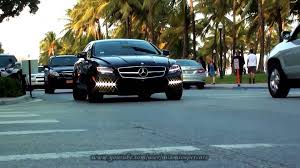 mercedes cls 63 amg black black mercedes cls 63 amg w218 with black rims driving